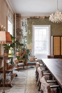 Unusual venue London. Boardroom with distressed walls and wooden furniture.
