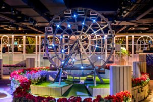 Unusual venue London. Indoor crazy golf with Ferris wheel.